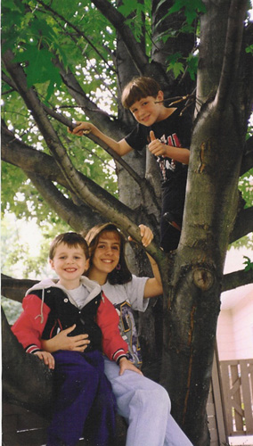 My brothers and I in a tree in our yard, early 90s